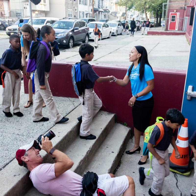 Julie Jackson greets students during morning arrival